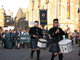 Clan Douglas (image 5) The Caledonian Brewery Pipe Band drummers lead Clan Douglas onto the Royal Mile