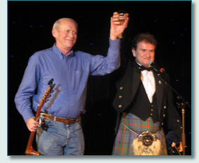 Archie Fisher and Hamish Burgess toasting Robert Burns on the Irish Music Cruise 2010