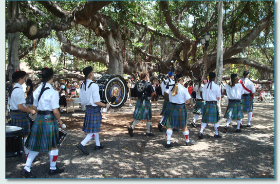 Hamish Burgess a& The Isle of Maui Pipeband at the 136th Birthday of the Lahaina Banyan Tree