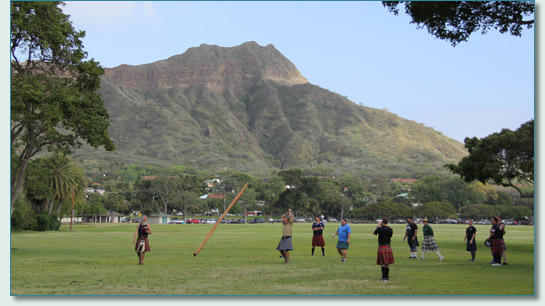 Heavy athletics lads tossing the Caber near Diamond Head, at the Hawaiian Scottish Festival 2013