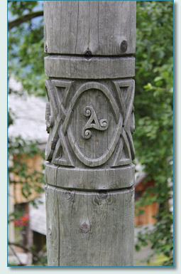 Carved triscele pole in the Celtic Village Hallein