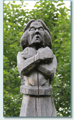 Carved Celtic warrior pole in the Celtic Village Hallein