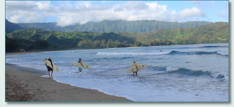 Chuck Wall, Hamish Burgess and Charlie Bass heading out to surf Hanalei Bay, Kauai