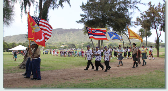 The Color Guard, Celtic Pipes & Drums of Hawaii and guests on Parade at the 32nd  Hawaiian Scottish Festival in Kapiolani Park, Waikiki, with Diamond Head beyond