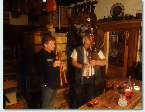 Hamish Burgess and Arnold Lobisser with dudelsack bagpipes in the Brauhaus workshop, Hallstatt, Austria