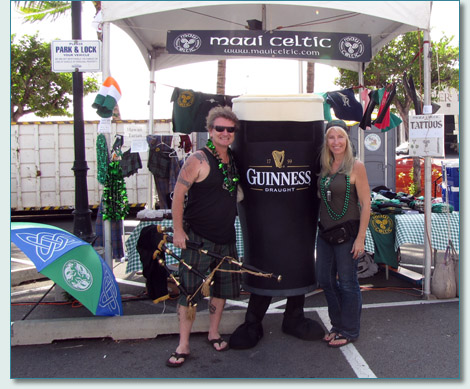 Hamish Burgess and Jennifer Fahrni at the Maui Celtic booth with a friendly Guinness - St.Patrick's Day blockparty, Honolulu 2010