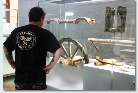 Hamish Burgess of Maui Celtic, and a Celtic wooden chariot wheel at the Latenium