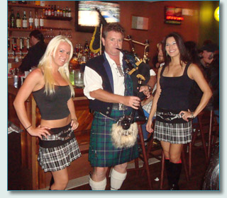 Hamish Burgess with Tia & Alisha, piping for the Bass Brigade St.Patrick's promotion in Honolulu