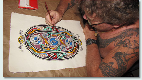 Hamish Burgess painting his 'Lindisfarne Spirals' reproduction, Maui 2009