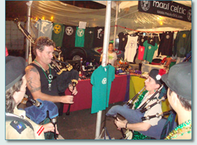 Hamish Burgess and Tina Yap piping at the Maui Celtic booth at he Honolulu S.Patrick's Day Block Party 2009