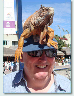 Robbie O'Connell with an Iguana on his head