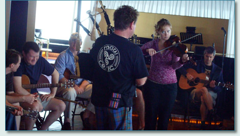 Hamish Burgess and Hanneke Cassel at a session on the Irish Music Cruise 2009